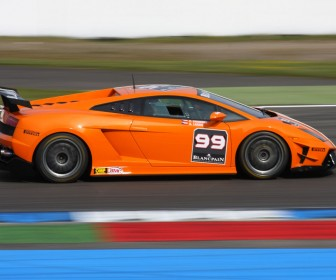 Super Trofeo Orange Side View Wallpaper